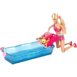 Barbie fait faire une course à des chiots.