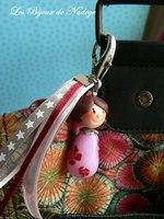 grigri de sac personnage fille rose