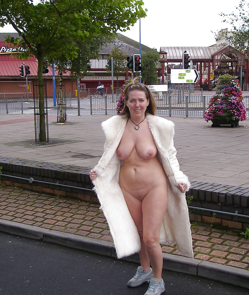 Naked under the coat at the train station slide show 7